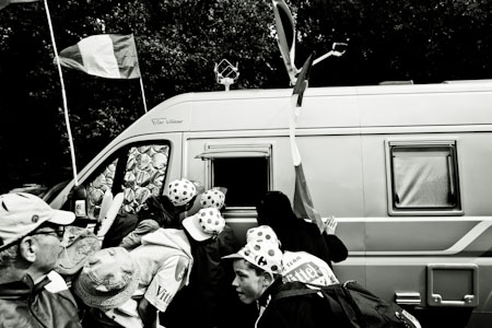 TDF Children watch the closing stages of stage 8 on a caravans tv set.
