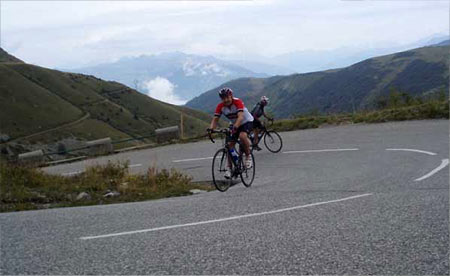 Jared closely followed by Bill on the steep part of the col de la Colombi?re